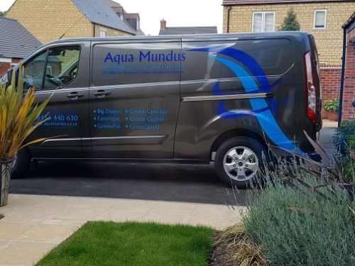 Aqua Mundus Servicing and Breakdown van parked outside